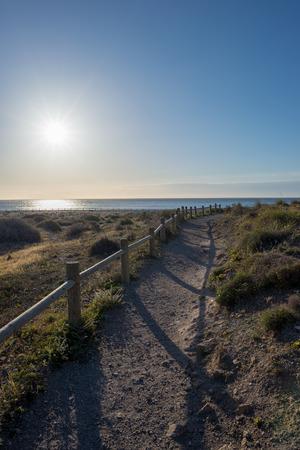 The beach of the dead with the sun and the blue sky, Spain