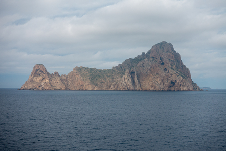 The island of es vedra from behind from a boat, Spain