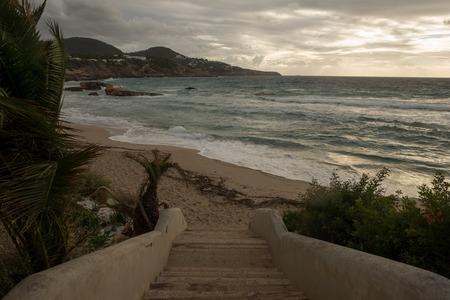 Cove in San Antonio de Ibiza a cloudy day, Spain