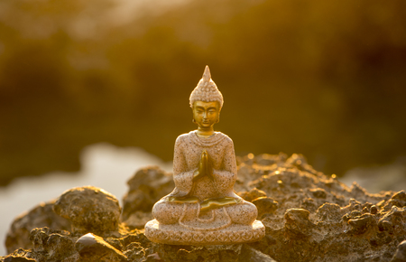 A buddha figure meditating on the coast, Spain Banque d'images - 115803503