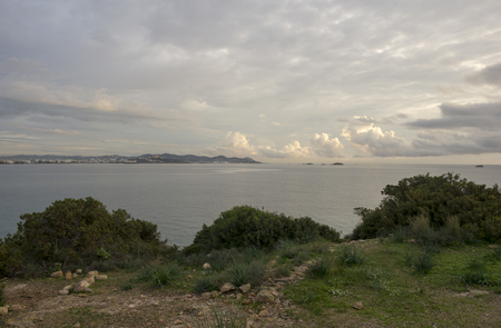 Viewpoint on the coast of Ibiza a cloudy day, Spain