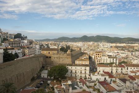 White houses around the town of Ibiza, Spain 免版税图像