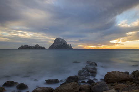 The island of Es Vedra in long exposure at sunset, Spain Imagens