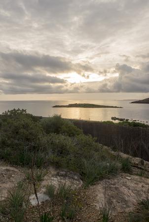 Cala de Sa Sal Rossa in Ibiza at sunrise, Spain