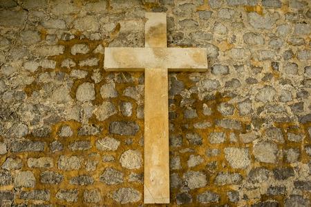 A Christian cross on a stone wall, Spain