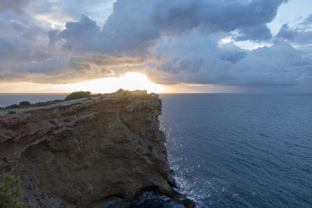 Cape Martinet on the island of Ibiza at dawn, Spain Фото со стока