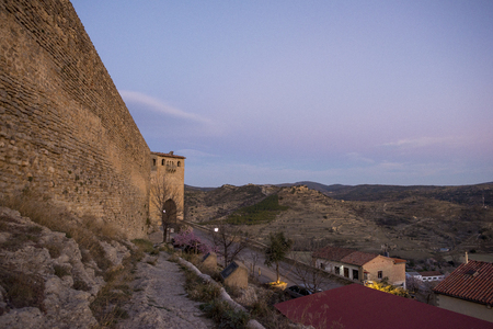 The walls of Morella in els ports during sunset, Spain