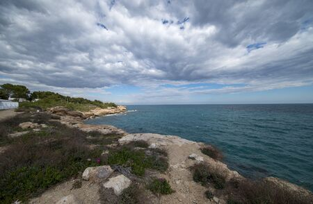 The sea in Calafat on the darted coast of Tarragona, Spain