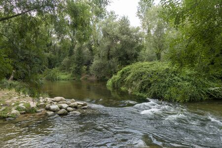 The river ter next to the greenway of Carrilet, Girona, Spain