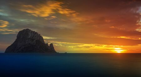 Sunset on the island of Es vedra in Ibiza, Spain