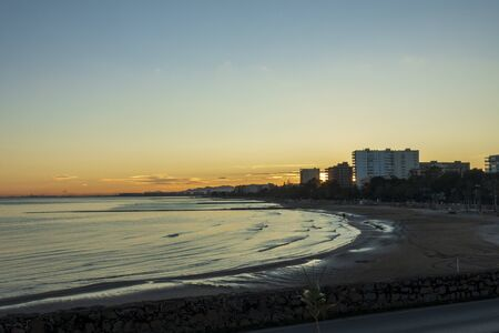 Sunset between the buildings on the coast of Benicassim, Costa Azahar, Spain