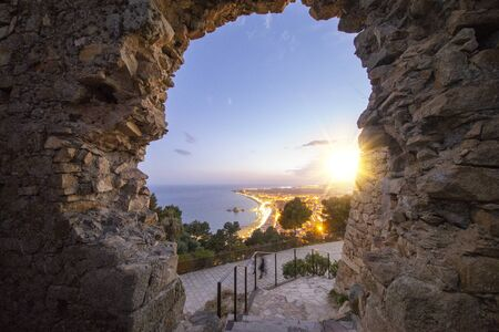 The sun at sunset from the hermitage of Blanes, Spain