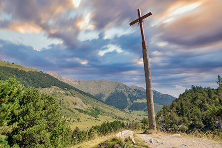 Christian cross on the road to montgarri from the valley of aran, Spain