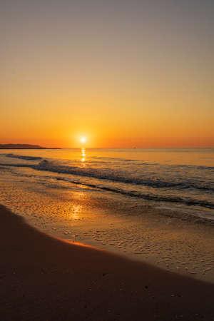 A peaceful sunrise on a beach on the Costa Azahar, Spain
