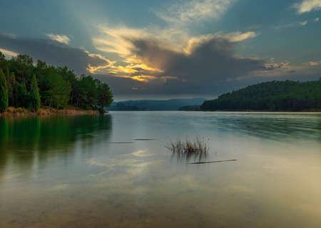 A calm lake at sunset with a cloudy sky, Spain Reklamní fotografie