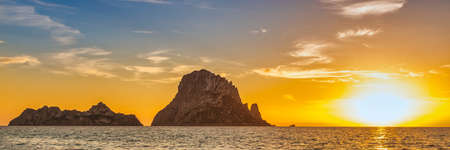 The island of Es Vedra from an Ibiza beach at sunset, Spain
