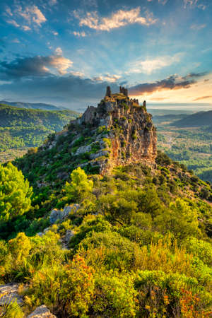 A ruined castle on the hill at sunset, Spain Reklamní fotografie