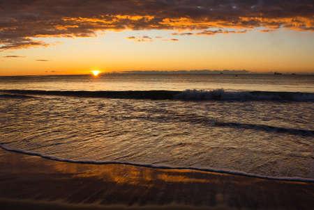 Cloudy sunrise on a beach in Benicasim, Spain