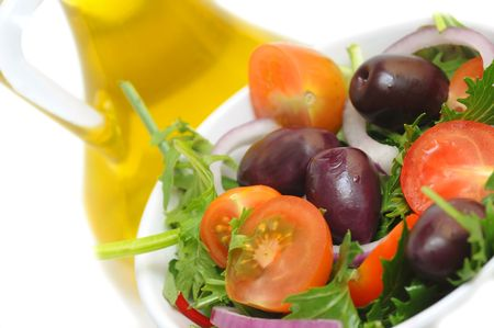 Salad with cherry tomatoes, onion and olives photo