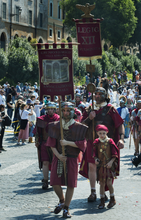 Rome / Italy / 04/22/2018, Rome foundation anniversary, Reenactment of a Roman legion by the historic group of villa Adrian for the 2771 roman anniversary. In the foreground legionars, even a child, held the roman ensemble In evidence the military clothin Editorial