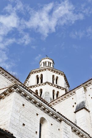 Beautiful bell tower of Cistercian abbey of Fossanova -Italy - in the foreground part of abbey exterior walls