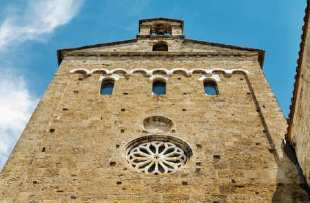 ANAGNI-ITALY-July 2020- part of cathedral southern side wall with rose window, windows and bell