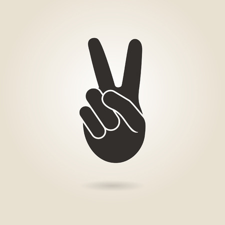victory sign: hand gesture victory symbol on a light background