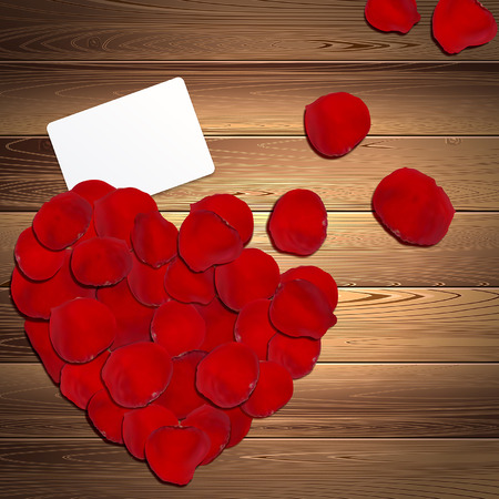 red rose petals: heart of red rose petals on the wooden background