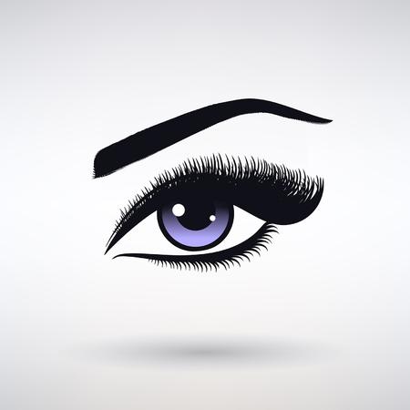 female eye with long eyelashes on a light background
