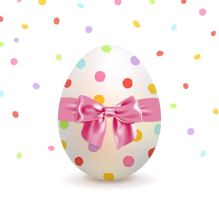 Painted Easter egg and colorful confetti on a white