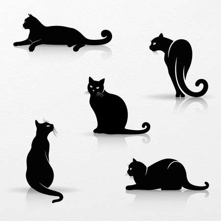 Set of stylized silhouettes of cats on white