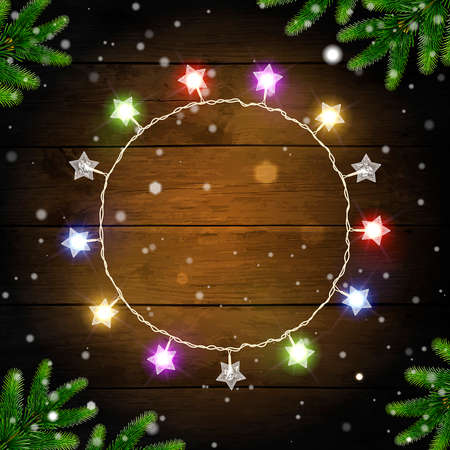 Christmas background with multicolored glowing garland and spruce branches