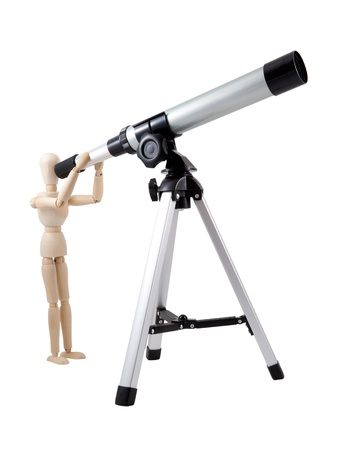 Wooden Puppet Observing with Telescope photo