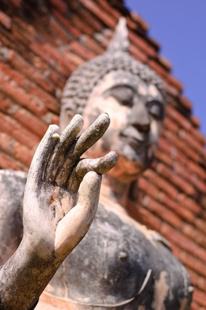 sukhothai: Buddha statue in blessing action at Sukhothai Historical Park, Thailand. Stock Photo