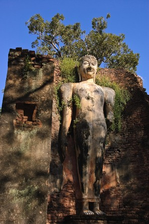 Ancient standing buddha image at Sukhothai Historical Park, Thailand. Stock Photo - 7300849