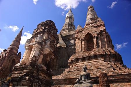 Ancient stupa and buddha image at Sukhothai Historical Park, Thailand. Stock Photo - 7300842