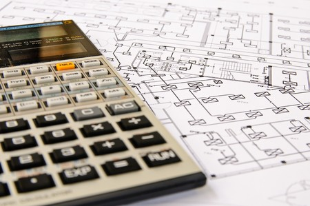 A calculator on a sheet of drawing. photo