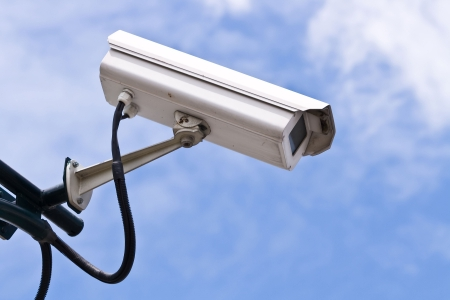 private security: Security Camera on blue sky Stock Photo
