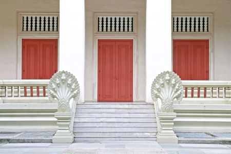 Traditional Thai Chinese style of Wooden door with Marble Step and Stone Carving in Naga Style photo