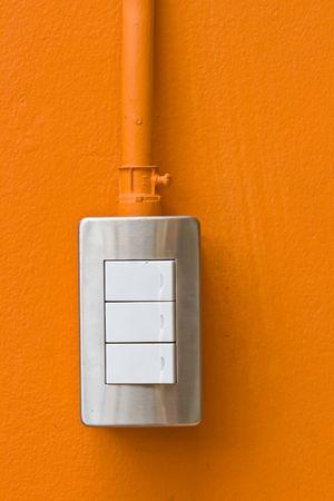 Light Switches on Orange Wall photo