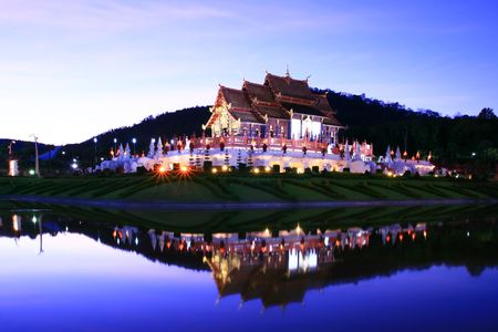 lanna: Reflection of Royal Pavilion in dusk, Thai Lanna Temple at Chianmai Northern of Thailand Stock Photo
