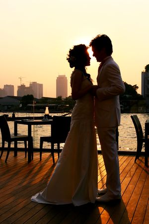 Bride and Groom kissing on the romantic wedding photo