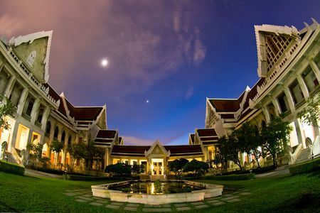 Dhevalai, Thai Temple in dusk,Thailand with Fish Eye Perspective photo