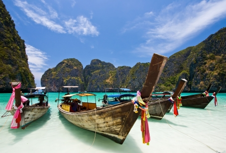 sky diving: Long Tails Boat at Maya bay, Phi-Phi Island , Phuket Thailand