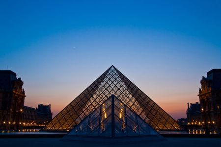 Paris France APR 16,2010 - Closeup of Louvre pyramid at Dusk during the Egyptian Antiquities Summer Exhibition in Paris. This is one of the most popular tourist destinations in France. Stock Photo - 7666080