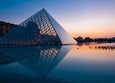 tourist destinations: Paris France APR 16,2010: Silhouette of Louvre pyramid at Evening during the Egyptian Antiquities Exhibition in Paris. This is one of the most popular tourist destinations in France.  Editorial