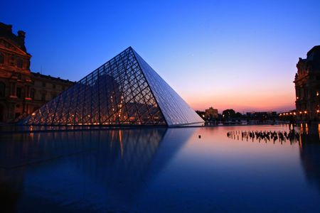 tourist destinations: Paris France APR 16,2010: Silhouette of Louvre Pyramid at dusk during the Summer Exhibition in Paris. This is one of the most popular tourist destinations in France.
