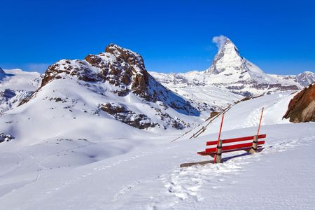 Landscape of Red chair and Matterhorn, logo of Toblerone chocolate, located in Switzerland