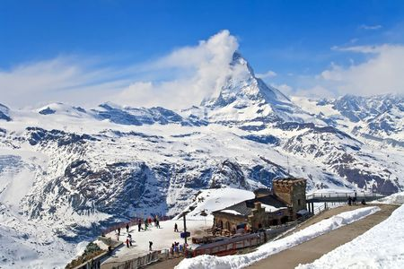traditional climbing: Landscape of Gornergrat Train Station and Matterhorn peak, logo of Toblerone chocolate, located at Switzerland