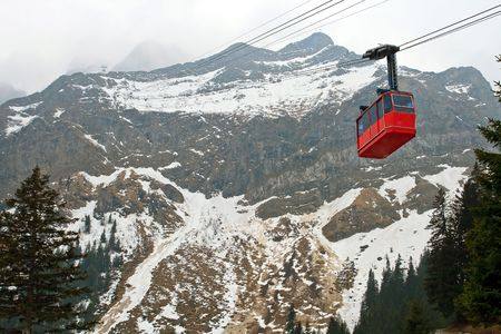 Red cable car railway and landscape of Pilatus Mountain at Lucern Switzerland photo